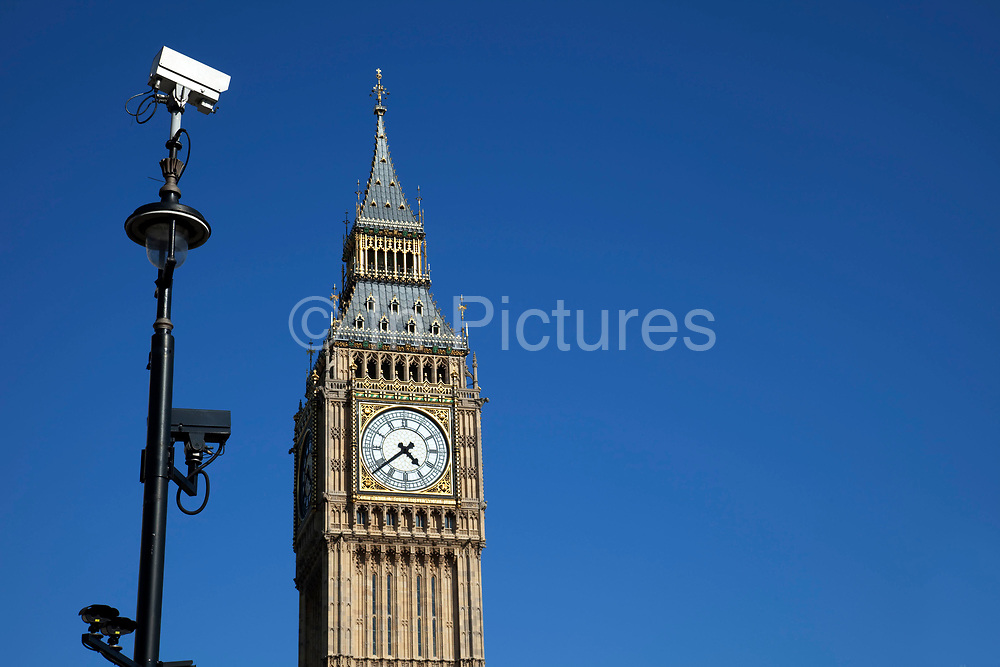 Big Ben and CCTV suveilance camera. The clock tower of the Houses of Parliament st Westminter, London. This icon of London is a big draw for tourism.
