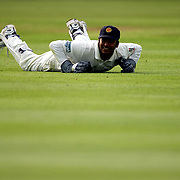 Sri Lanka's wicket keeper Kumar Sangkkara lies on the pitch after missing a catch of the bat of England's Graham Thorpe.