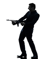 one  man holding thompson machine gun in silhouette on white background