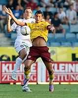 Fotball<br /> 21.07.2010<br /> Foto: Gepa/Digitalsport<br /> NORWAY ONLY<br /> <br /> SK Sturm Graz vs Arsenal FC<br /> <br /> Bild zeigt Marouane Chamakh (Arsenal) und Gordon Schildenfeld (Sturm).