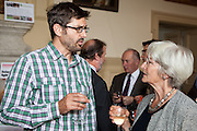Broadcaster Loius Theroux talking to Lady Sainsbury at the 2010 Ashden Awards reception.