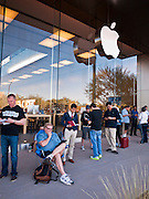 14 OCTOBER 2011 - SCOTTSDALE, AZ:   People wait in line at the Apple Store in Scottsdale Quarter to buy the new iPhone 4S. Hundreds of people lined up at the Apple Store in the Scottsdale Quarter in Scottsdale, AZ, Friday, Oct. 14, to buy the iPhone 4S. The phone sold out in pre-orders last week and sales at the Scottsdale Apple Store were brisk through the morning.   PHOTO BY JACK KURTZ
