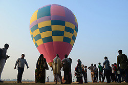 October 17, 2016 - Allahabad, India - Indian pilgrims,who visit for Holy dip, look on  hot air balloon ,on the banks of holy Sangam,the confluence of Ganges River,Yamuna river and Mythological Saraswati river, in Allahabad on October 17,2016. The State Government and Administrative officials conduct an awareness initiative  for Electors parternership programme ahead of state assembly elections in Uttar Pradesh. (Credit Image: © Ritesh Shukla/NurPhoto via ZUMA Press)
