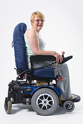 Portrait of a female wheelchair user smiling,
