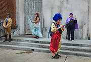 The Society of Saint Anne practicing social distancing during Mardi Gras on 25th February 2020 in the Bywater district of New Orleans, Louisiana, United States. Mardi Gras is the biggest celebration the city of New Orleans hosts every year. The magnificent, costumed, beaded and feathered party is laced with tradition and  having a good time. Celebrations are concentrated for about two weeks before and culminate on Fat Tuesday the day before Ash Wednesday and Lent.