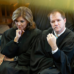Texas Supreme Court Justice Eva Guzman, left, with Justice Don Willett, is shown at the State of the Judiciary ceremony at the Texas Capitol on March 6, 2013.   Guzman, the first Hispanic woman to serve on the Texas Supreme Court, resigned her position and is rumored to be considering a challenge to Attorney General Ken Paxton.
