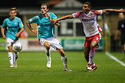 Forest Green Rovers Christian Doidge(9) takes on Stevenage's Luther Wildin(2) during the EFL Sky Bet League 2 match between Forest Green Rovers and Stevenage at the New Lawn, Forest Green, United Kingdom on 21 August 2018.