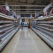 Shopper empty shelf at Tesco of the #coronavirus threat, London, UK