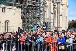 Crowds watch guests arriving at York Minster for the wedding of singer Ellie Goulding to Caspar Jopling.