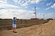 Anti-fracking  Oklahoma activist Angela Spotts across from a drilling rig at a hydraulic fracturing site near her home on the outskirts of Stillwater, Ok.