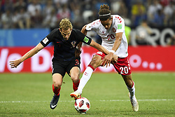 July 1, 2018 - Nizhny Novgorod, Russia - Ivan Strinic of Croatia and Yussuf Yurary Poulsen of Denmark during the 2018 FIFA World Cup Round of 16 match between Croatia and Denmark at Nizhny Novgorod Stadium in Nizhny Novgorod, Russia on July 1, 2018  (Credit Image: © Andrew Surma/NurPhoto via ZUMA Press)