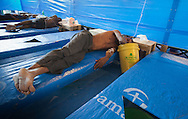 Man being treated for cholera in Port-au-Prince at a Samaritan's Purse clinic. Samaritan's Purse, an NGO, openned a second cholera clinic in Cité Soleil on November 29th with 200 beds.