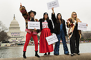 Demonstrators pose in front of the U.S. Capitol building during the Women's March on Washington in protest to President Donald Trump January 21, 2017 in Washington, DC. More than 500,000 people crammed the National Mall in a peaceful and festival rally in a rebuke of the new president.
