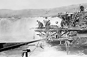 9305-B7356. close-up of Indians fishing at Celilo Falls