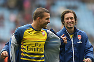 Lukas Podolski (l) and Tomas Rosicky of Arsenal enjoy a joke as they leave the field after a pre-match warm up. Barclays Premier league match, Aston Villa v Arsenal at Villa Park in Birmingham on Saturday 20th Sept 2014<br /> pic by Mark Hawkins, Andrew Orchard sports photography.