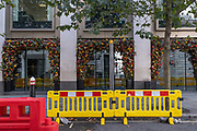 In an empty City of London financial district, whose workforce are largely still working from home during the second (Autumn) spike Coronavirus pandemic,  social distance pavement-widening bariers outside a closed City bar at lunchtime on Gresham Street, on 5th October 2020, in London, England.