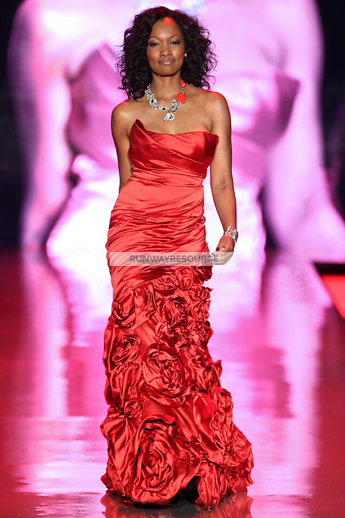 Garcelle Beauvais walks the runway wearing Monique Lhuillier during Heart Truth Red Dress Collection Fall 2011 during Mercedes-Benz Fashion Week in New York on February 9, 2011