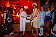 Fancy dress competitors, Butlins Holiday camp, Skegness. Butlins Skegness is a holiday camp located in Ingoldmells near Skegness in Lincolnshire. Sir William Butlin conceived of its creation based on his experiences at a Canadian summer camp in his youth and by observation of the actions of other holiday accommodation providers, both in seaside resort lodging houses and in earlier smaller holiday campsThe camp began opened in 1936, when it quickly proved to be a success with a need for expansion. The camp included dining and recreation facilities, such as dance halls and sports fields. Over the past 75 years the camp has seen continuous use and development, in the mid-1980s and again in the late 1990s being subject to substantial investment and redevelopment. In the late 1990s the site was re-branded as a holiday resort, and remains open today as one of three remaining Butlins resorts.