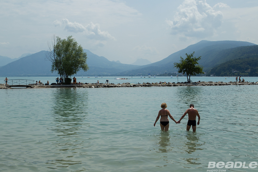 A couple venture into Lac Annecy. Specialized Bicycle Components hosted a VIP experience for select media joining the last four stages of the 2013 Tour de France. Image by Greg Beadle