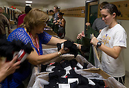 West Point, New York - Cadet candidates line up to get military clothing during Reception Day at the United States Military Academy at West Point on July 2, 2014. About 1,200 cadet candidates, the West Point Class of 2018, reported to the academy to begin their military careers.
