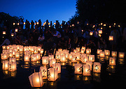 People wade into the water of Green Lake to release paper lanterns during the annual From Hiroshima to Hope event, which observes the anniversary of the Hiroshima and Nagasaki atomic bombings, with performances and a lantern ceremony. The year 2015 marked the 70th anniversary of the bombings that preceded Japan's surrender in World War II. (Lindsey Wasson/The Seattle Times)