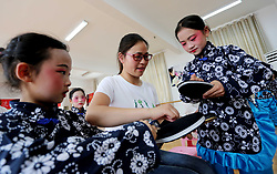 May 31, 2017 - Lianyungang, Lianyungang, China - Lianyungang, CHINA-May 31  2017: (EDITORIAL USE ONLY. CHINA OUT)..Children wearing traditional clothes learn Chinese traditional opera in Lianyungang, east China's Jiangsu Province, May 31st, 2017. (Credit Image: © SIPA Asia via ZUMA Wire)