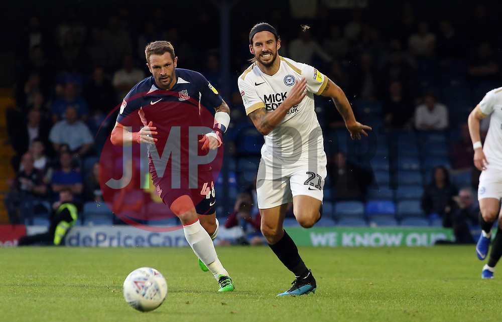 George Boyd of Peterborough United in action wtih John White of Southend United - Mandatory by-line: Joe Dent/JMP - 20/08/2019 - FOOTBALL - Roots Hall - Southend-on-Sea, England - Southend United v Peterborough United - Sky Bet League One