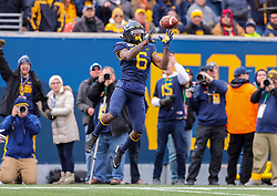 Nov 9, 2019; Morgantown, WV, USA; West Virginia Mountaineers running back Kennedy McKoy (6) catches a pass for a touchdown during the second quarter against the Texas Tech Red Raiders at Mountaineer Field at Milan Puskar Stadium. Mandatory Credit: Ben Queen-USA TODAY Sports