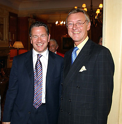 Left to right,  MICHAEL PORTILLO and WILLIAM COWPE at a garden party at the Goring Hotel, Beeston Palce, London SW1 to celebrate the unveiling of a bronze bust the late Queen Elizabeth the Queen Mother on 20th July 2004.