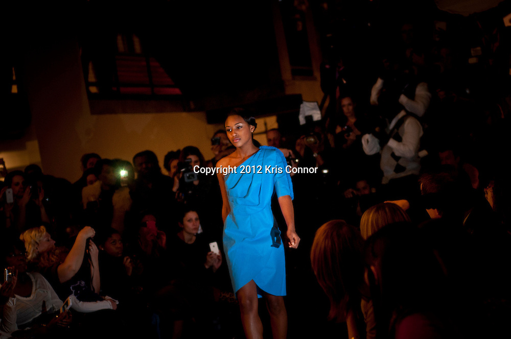Caption: A model walks the runway during the Kickoff Reception & Eco Fashion Show at the Mammoth Theatre in Washington DC on February 20, 2012.