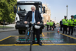 © licensed to London News Pictures. London, UK 04/09/2013. Mayor of London, Boris Johnson attending to a photocall to unveil plans to tackle HGV blind spots to improve cycle safety in London on Tuesday, September 4, 2013. Photo credit: Tolga Akmen/LNP