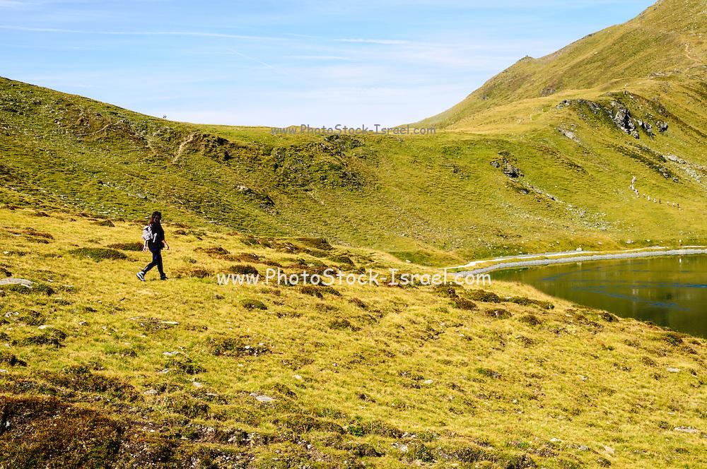 Female hiker on Konigsleiten mountain top. Zillertal, Tyrol, Austria