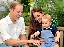 EDITORIAL USE ONLY<br /> This photo dated Wednesday July 2, 2014, was taken to mark Prince George's first birthday and shows the Duke and Duchess of Cambridge and the Prince during a visit to the Sensational Butterflies exhibition at the Natural History Museum, London.