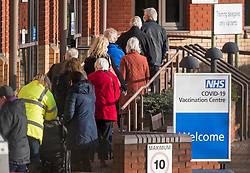 © Licensed to London News Pictures. 11/01/2021. Stevenage, UK. Elderly members of the public queue to enter a COVID-19 vaccination hub at Robertson House at Hertfordshire Development Centre in Stevenage, Hertfordshire, which has opened for the first time today (Mon). Photo credit: Ben Cawthra/LNP
