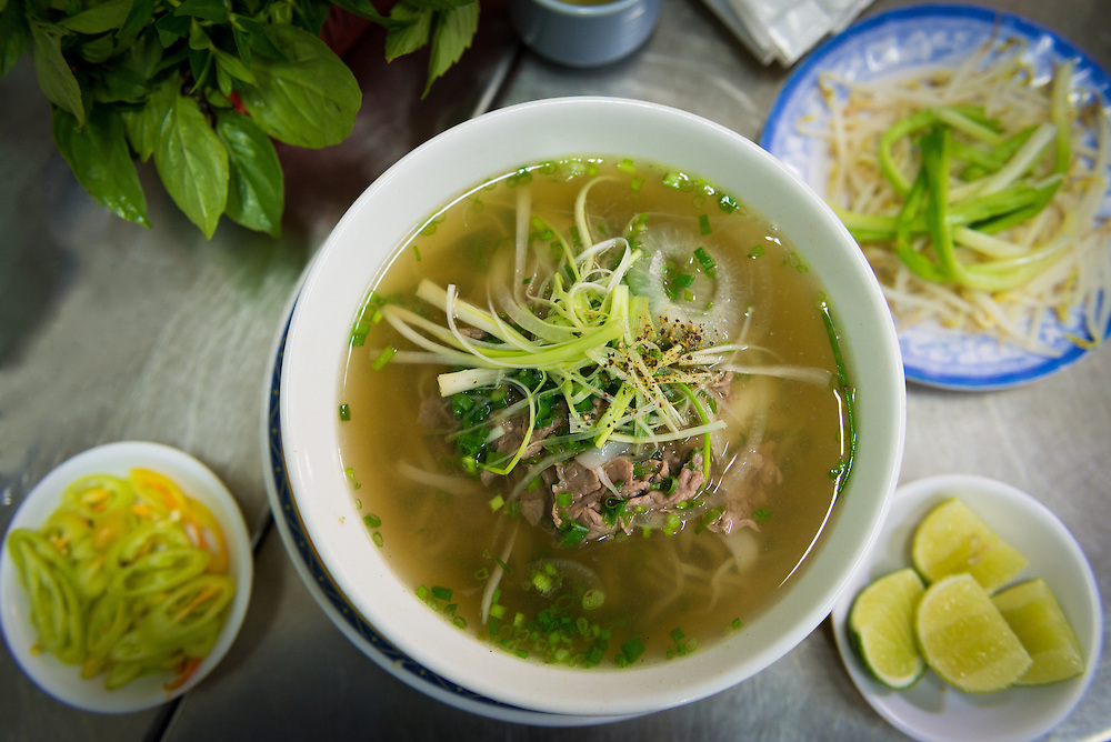 Bowl of pho bo with condiments