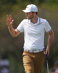 September 24, 2017 - Atlanta, GA, USA - Russell Henley makes his birdie putt on the 1st hole during the final round of the Tour Championship at East Lake Golf Club in Atlanta on Sunday, Sept. 24, 2017. (Credit Image: © Curtis Compton/TNS via ZUMA Wire)