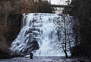 A fly fisherman tries his luck just below the Ithaca Falls in Ithaca, NY, Tuesday, November 21, 2017.  Cornell University is looking to block access to the gorge above Ithaca Falls, accessible through Ezra's Tunnel, which has long served as a local swimming hole but has also been the site of two students' drowning deaths in the last seven years. <br /> (Heather Ainsworth for The New York Times)