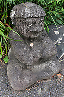 Kappa at Sogenji Temple, Kappabashi Tokyo - The Kappa Kawataro is a water spirit of Japan, with webbed hands and feet and a tortoise shell.  Crowning their head of page-boy style hair is a circular depression filled with water.  Such demons are said to be the ghosts of drowned souls.  They have immense strength - the source of this power comes from the stored water within the dish on their head.  Activities from this demon can range from mischievous to deadly. It enjoys passing gas and forever gives off a fishy odour.  The kappa enjoys vegetarian cuisine particularly eggplants and cucumbers.  Sogenji Temple in Kappabashi Tokyo is devoted to Kappa, so much so that it is usually called Sogenji Kappa Temple.
