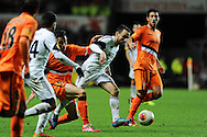 Leon Britton of Swansea city © makes a break. UEFA Europa league match, Swansea city v Valencia at the Liberty Stadium in Swansea on Thursday 28th November 2013. pic by Andrew Orchard, Andrew Orchard sports photography,