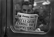 Commuters reading the Evening News on a Southern region train delayed in Charing Cross station. Evening News, formerly known as The Evening News, was an evening newspaper published in London from 1881 to 1980, reappearing briefly in 1987. It became highly popular under the control of the Harmsworth brothers. For a long time it maintained the largest daily sale of any evening newspaper in London. After financial struggles and falling sales it was eventually merged with its long-time rival the Evening Standard in 1980. Coming and Going is a project commissioned by the Museum of London for photographer Barry Lewis in 1976 to document the transport system as it is used by passengers and commuters using public transport by trains, tubes and buses in London, UK.