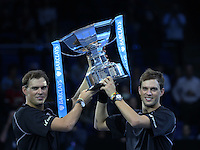Bob Bryan and Mike Bryan with Trophy after beating Ivan Dodig and Marcelo Melo in their Doubles Final match<br /> <br /> Photographer Kieran Galvin/CameraSport<br /> <br /> International Tennis - Barclays ATP World Tour Finals - O2 Arena - London - Day 8 - Sunday 16th November 2014<br /> <br /> © CameraSport - 43 Linden Ave. Countesthorpe. Leicester. England. LE8 5PG - Tel: +44 (0) 116 277 4147 - admin@camerasport.com - www.camerasport.com