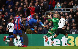 Crystal Palace's Wilfried Zaha clashes with Liverpool goalkeeper Loris Karius which results in a penalty