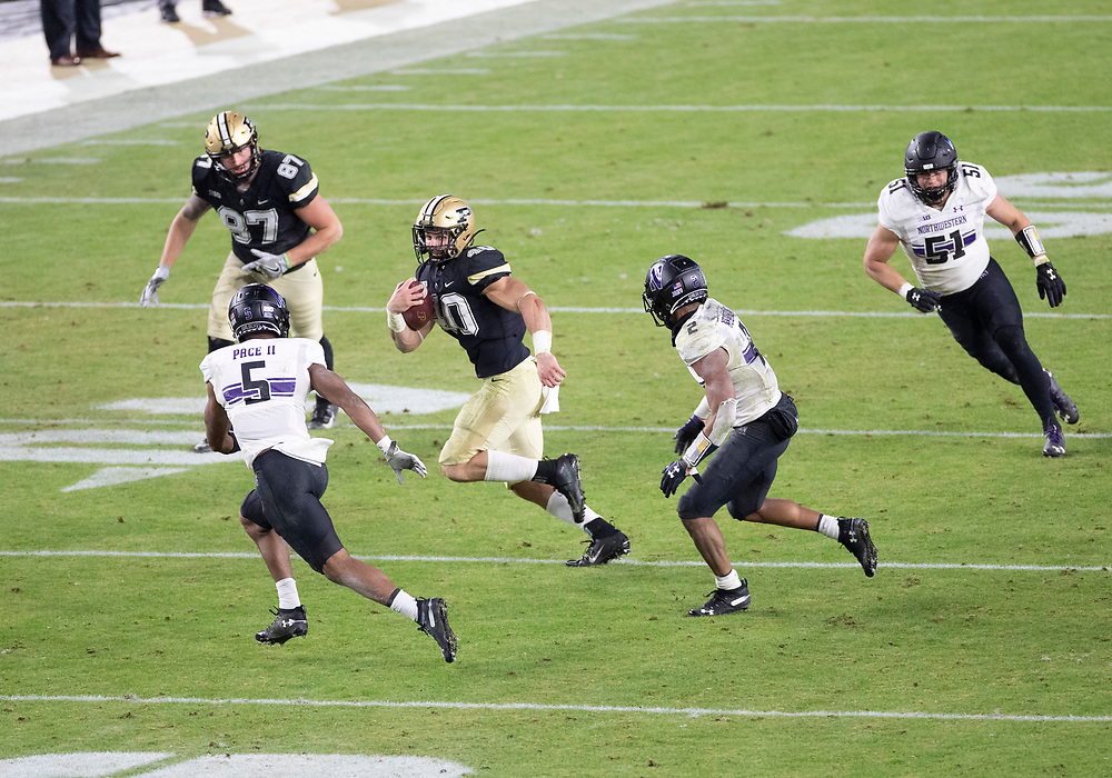 November 14, 2020:  Purdue running back Zander Horvath (40) runs with the ball as Northwestern defensive back JR Pace (5) pursues during NCAA football game action between the Northwestern Wildcats and the Purdue Boilermakers at Ross-Ade Stadium in West Lafayette, Indiana. Northwestern defeated Purdue 27-20.  John Mersits/CSM.