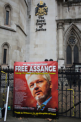 A banner placed by supporters of Wikileaks founder Julian Assange outside the High Court following a March for Assange from BBC Broadcasting House organised by the Don't Extradite Assange campaign is pictured on 23rd October 2021 in London, United Kingdom. The US government will begin a High Court appeal on 27th October against a decision earlier this year not to extradite Assange to face espionage charges in the United States. Assange has been held in Belmarsh Prison since 2019. (photo by Mark Kerrison/In Pictures via Getty Images)