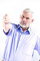 caucasian senior man portrait thumb down failure isolated studio on white background