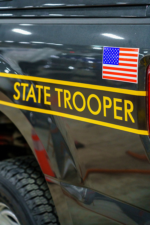 Harrisburg, PA / USA - January 8, 2020: Close up of the State Trooper ID on a Pennsylvania State Police vehicle, on display at the annual PA Farm Show.