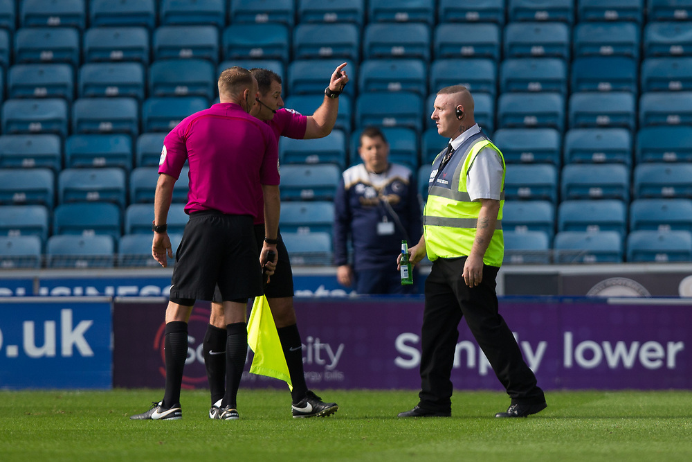 A steward removes a beer bottle which had been thrown onto the pitch <br /> <br /> Photographer Craig Mercer/CameraSport<br /> <br /> Saturday 16th September 2017<br /> <br /> World Copyright © 2017 CameraSport. All rights reserved. 43 Linden Ave. Countesthorpe. Leicester. England. LE8 5PG - Tel: +44 (0) 116 277 4147 - admin@camerasport.com - www.camerasport.com