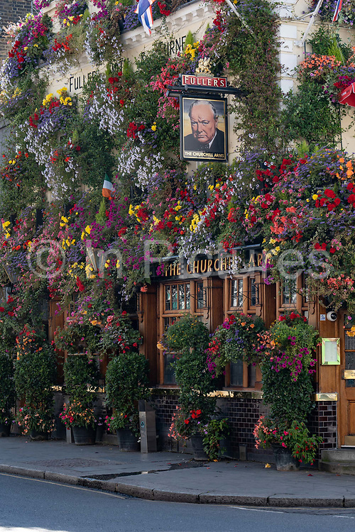 Colourful flowers decorate the exterior walls of The Churchill Arms pub in Kensington on the 17th September 2019 in London in the United Kingdom.