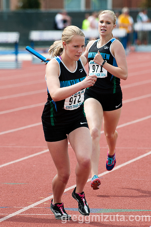 Mountain View junior Allison Ellingson passes the baton to her sister, Holly Ellingson, to start the third leg of the 5A 4x800 relay during the State Track & Field Championships at Dona Larsen Park, Boise, Idaho on May 16, 2014. Mountain View (Erin Hagen, Allison Ellingson, Holly Ellingson, Samantha McKinnon) placed first with a time of 9:19.49.