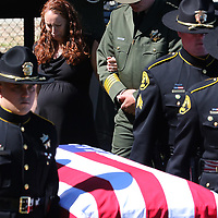 Faviola Del Real holds onto the arm of Santa Cruz County Sheriff Jim Hart as she follows the flag-draped coffin of her husband, Sheriff's Deputy Sgt. Damon Gutzwiller, into a memorial service at Cabrillo College in Aptos, California on June 17, 2020 for the fallen deputy who was killed in the line of duty on June 6.  Officers from police, sheriffs and fire departments from around northern California attended the service for Deputy Gutzwiller, who was gunned down in an ambush in Ben Lomond, California.